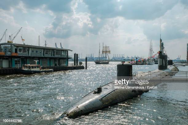 submarine on river against sky - submarine stock pictures, royalty-free photos & images