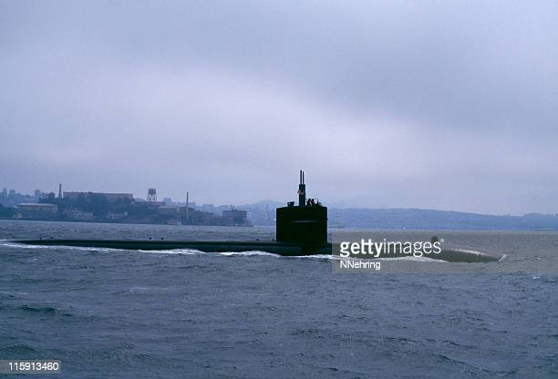 submarine slipping out to sea under fog san francisco bay - submarine stock photos and pictures