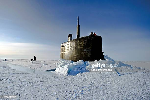 Submarine USS Connecticut surfaces above the ice.