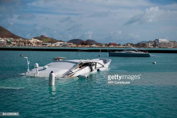 TOPSHOT Submerged boats are seen at the Fort Louis Marina in Marigot September 8 2017 in SaintMartin island devastated by Hurricane Irma Officials on...