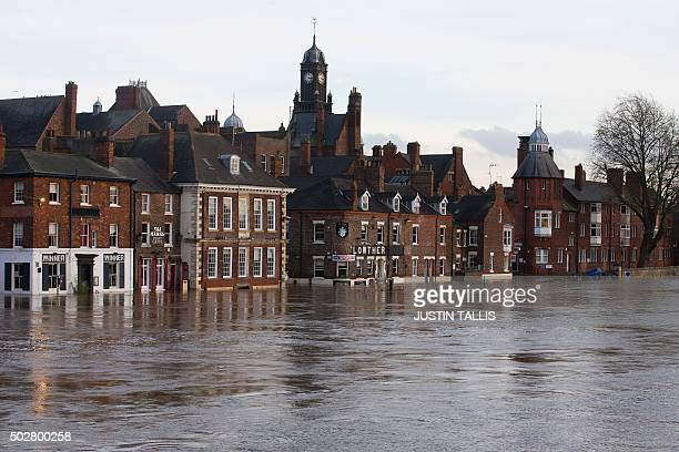 Submerged buildings overlooking the river Ouse are pictured late in the afternoon in York northern England on December 29 2015 Residents in the...