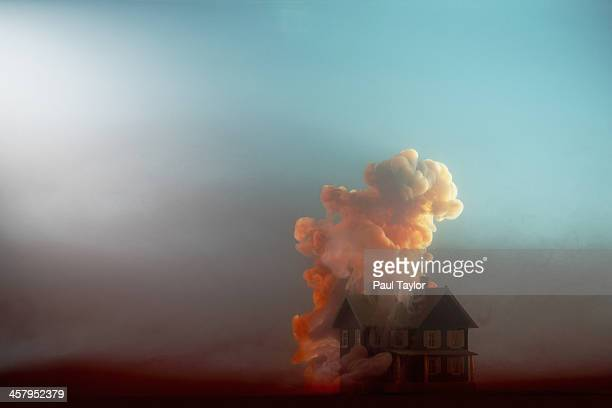 submerged house - burning stock pictures, royalty-free photos & images