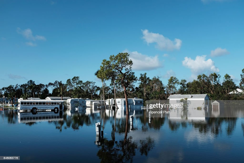 A submerged mobile home community stands in Fort Myers two days after Hurricane Irma swept through the area on September 12, 2017 in Fort Myers Florida. Hurricane Irma made another landfall near Naples yesterday after inundating the Florida Keys. Electricity was out in much of the region with extensive flooding.
