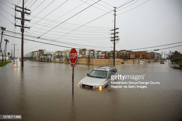 A submerged SUV sits in the intersection of Pomona Avenue and 17th Street in Costa Mesa CA on Thursday Dec 6 2018Heavy rain from a winter storm...