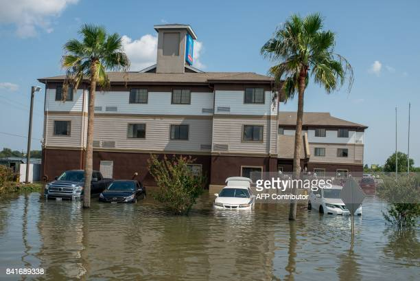 Submerged vehicles outside a Motel 6 in Port Arthur Texas on Thursday September 1 2017 Stormweary residents of Houston and other Texas cities began...
