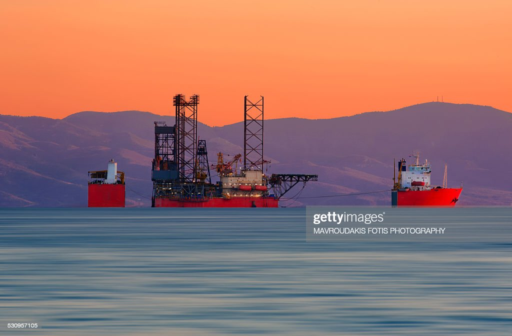 Submerging cargo ship : Stock Photo