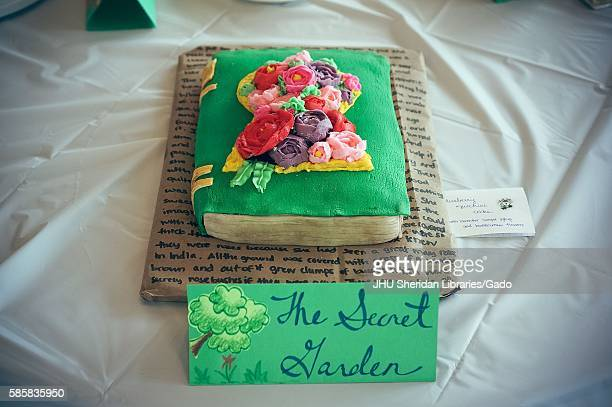 Submission for Read It and Eat It contest and edible book festival at Milton S Eisenhower Library Johns Hopkins University showing a cake made of a...