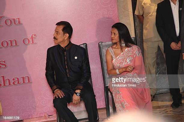 Subrata Roy and wife Swapna Roy during Annaprashan ceremony of their granddaughter Roshna on March 20 2013 in New Delhi India