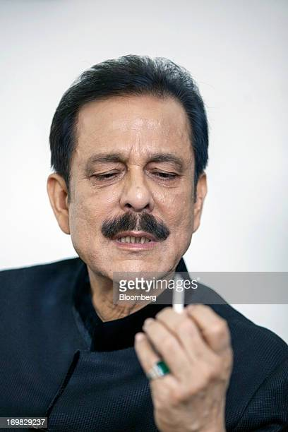 Subrata Roy chairman of Sahara Group holds a cigarette as he speaks during an interview in Lucknow India on Monday May 6 2013 Roy's closely held...