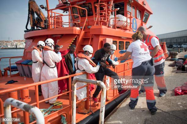 A subSaharan is help by Red Cross volunteers to disembark after 143 Moroccans and 9 subSaharans were rescued in the waters of the Strait of Gibraltar...