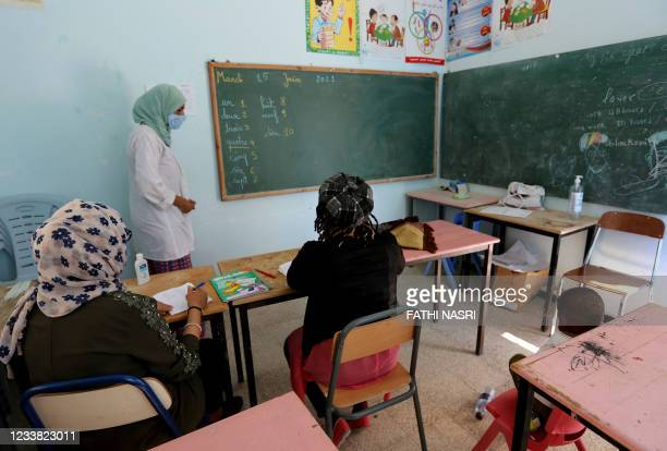 Sub-Saharan migrant women learn french at a centre run by the Organisation for the Support of Migrants, in the southern Tunisian city of Medenine on...