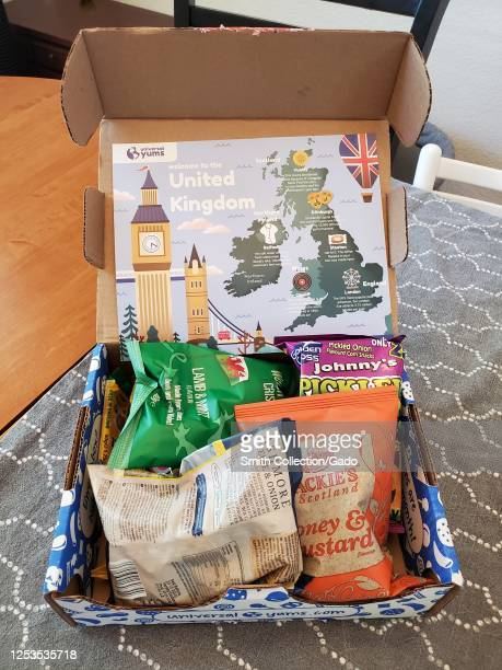 Subscription box from Universal Yums featuring monthly snacks from different countries, United Kingdom edition, on table in San Ramon, California,...