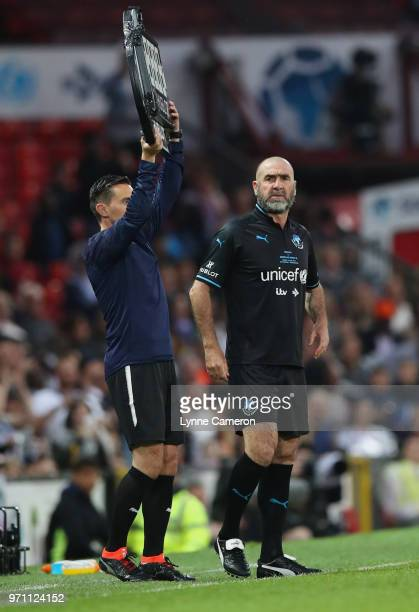 Subsitute Eric Cantona of the Rest of the World looks on during the Soccer Aid for UNICEF 2018 match between Englannd and the Rest of the World at...