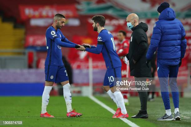 Substitute, Christian Pulisic of Chelsea replaces team mate Hakim Ziyech during the Premier League match between Liverpool and Chelsea at Anfield on...