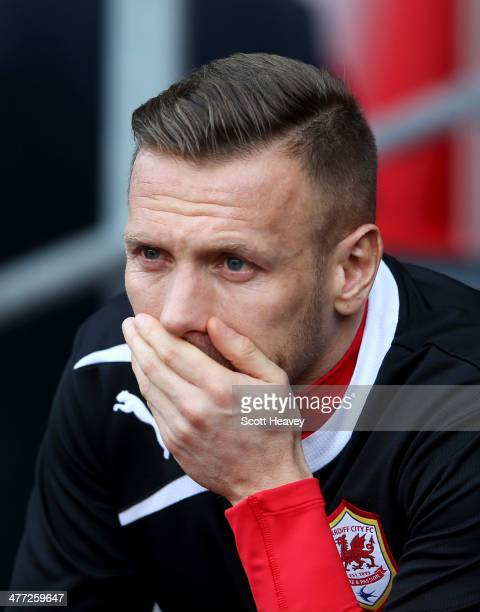 Substitute Craig Bellamy of Cardiff City looks on prior to the Barclays Premier League match between Cardiff City and Fulham at Cardiff City Stadium...