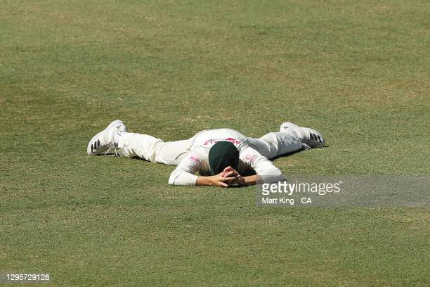 Substitute fielder Sean Abbott of Australia reacts after a missed catching chance on Ravichandran Ashwin of India during day five of the Test match...