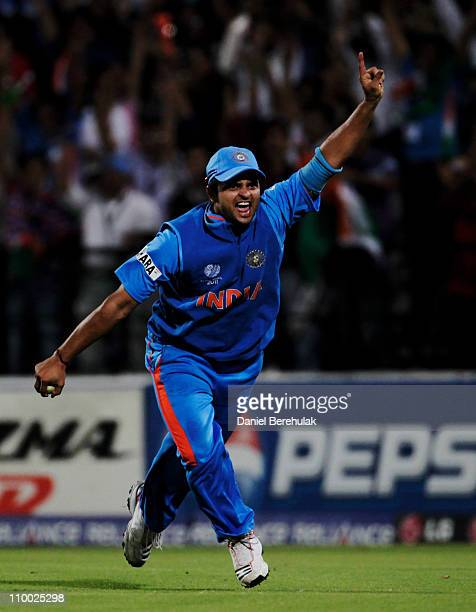 Substitute fieldsman Suresh Raina of India celebrates after taking the catch to dismiss Johan Both of South Africa off the bowling of MunafPatel of...