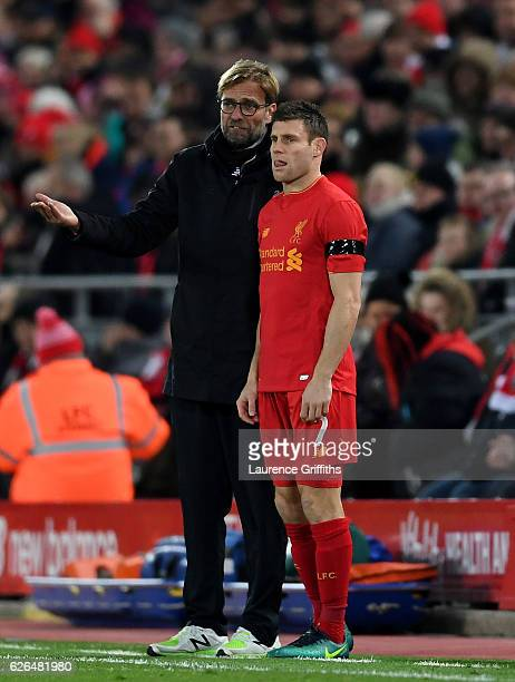 Substitute James Milner of Liverpool stands alongside Jurgen Klopp manager of Liverpool during the EFL Cup QuarterFinal match between Liverpool and...