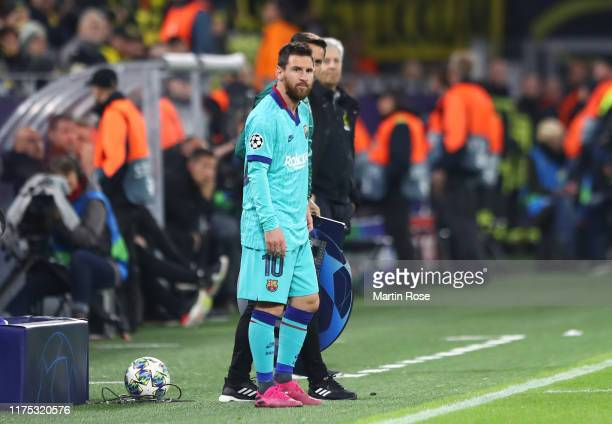 Substitute Lionel Messi of FC Barcelona looks on from the touchline during the UEFA Champions League group F match between Borussia Dortmund and FC...