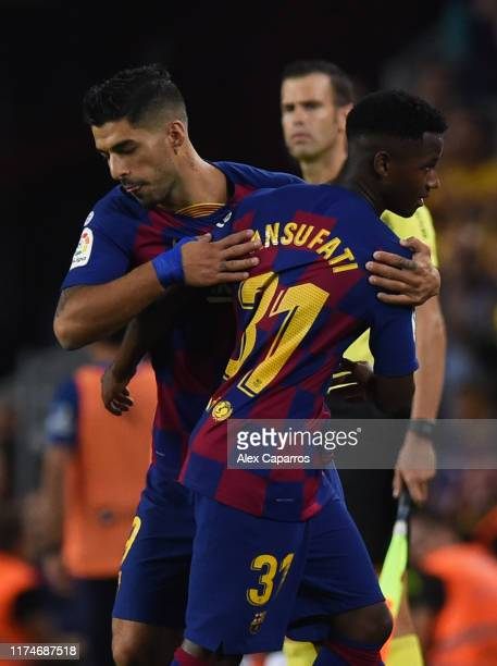 Substitute Luis Suarez of FC Barcelona replaces Anssumane Fati during the Liga match between FC Barcelona and Valencia CF at Camp Nou on September 14...