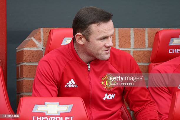 Substitute Manchester United's English striker Wayne Rooney is pictured on the bench ahead of the English Premier League football match between...