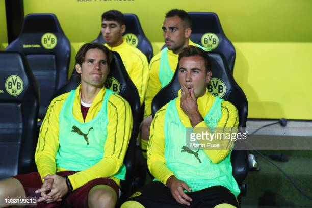 Substitute Mario Gotze of Borussia Dortmund sits on the bench with Marwin Hitz of Borussia Dortmund prior to the Bundesliga match between Borussia...