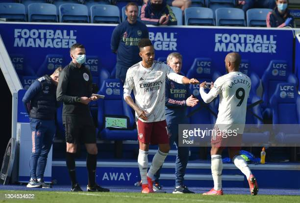 Substitute, Pierre Emerick Aubameyang of Arsenal replaces team mate Alexandre Lacazette during the Premier League match between Leicester City and...