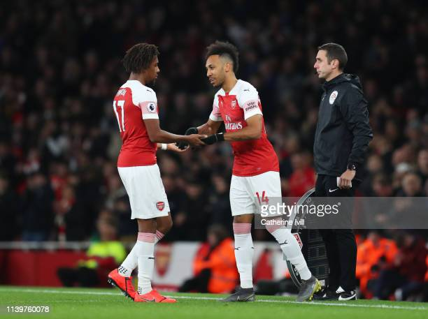 Substitute Pierre-Emerick Aubameyang of Arsenal replaces Alex Iwobi during the Premier League match between Arsenal FC and Newcastle United at...