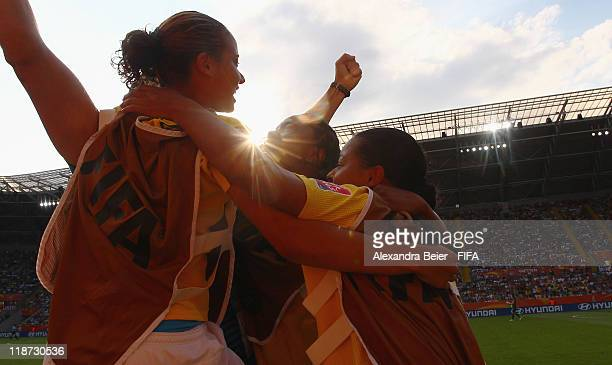 Substitute players Francielle Renata Costa and Thais Guedes of Brazil celebrate their team's penalty goal during the FIFA Women's World Cup quarter...