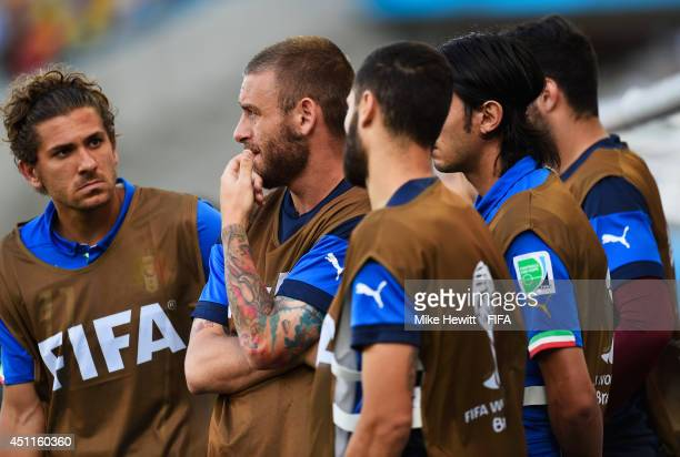 Substitute players of Italy are seen on the bench during the 2014 FIFA World Cup Brazil Group D match between Italy and Uruguay at Estadio das Dunas...