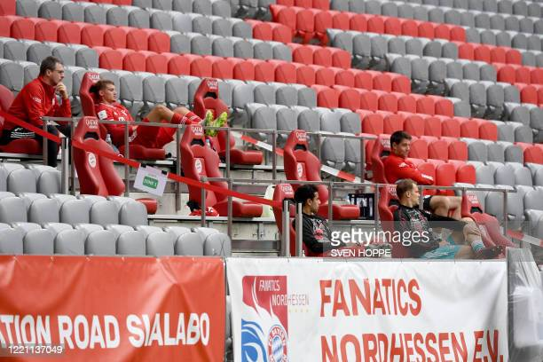 Substitute players sit in the stands during the German first division Bundesliga football match FC Bayern Munich v SC Freiburg on June 20, 2020 in...