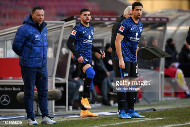 Substitute, Sami Khedira of Hertha BSC prepares to enter the pitch as Pal Dardai, Head Coach of Hertha BSC looks on during the Bundesliga match...