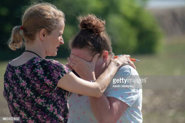 Substitute teacher Joanie Lynne consoles instructional assistant Paige Rose outside Noblesville West Middle School after a shooting at the school on...