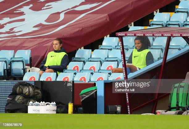 Substitutes Lucy Whipp and Destiny Toussaint of Birmingham look on from the bench during the Barclays FA Women's Super League match between Aston...