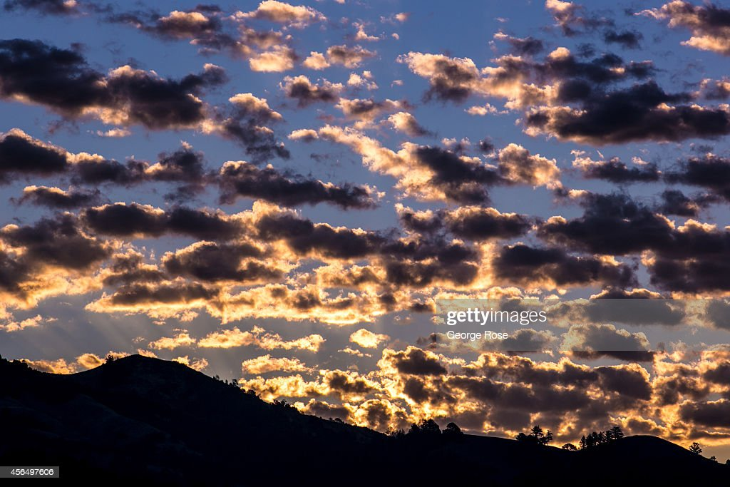 Sub-tropical clouds provide a spectacular sunrise behind Mount St. Helena on September 15, 2014, near Healdsburg, California. Warm sunny skies in Sonoma County Wine Country have made for excellent grape growing conditions. Despite the drought, the 2014 grape harvest is early and average in terms of tonnage.