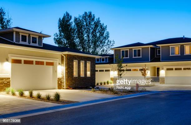 suburb houses at dusk - illuminated stock pictures, royalty-free photos & images
