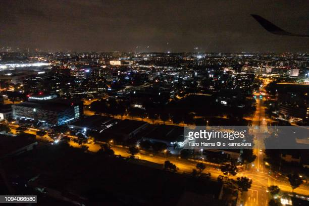 Suburb of Singapore city night time aerial view from airplane