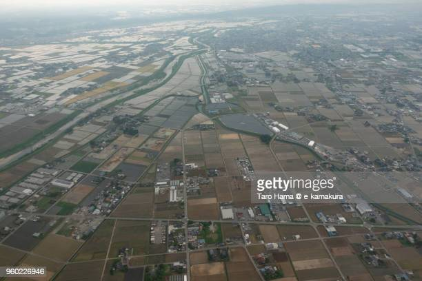 Suburb of Toyama city in Japan daytime aerial view from airplane