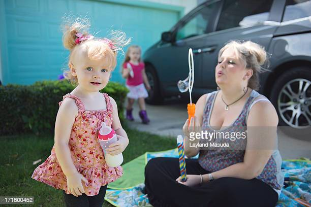 suburb summer - mother and daughters - big cleavage stock photos and pictures