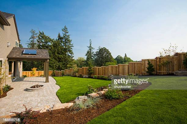 suburban back yard - fence stock pictures, royalty-free photos & images