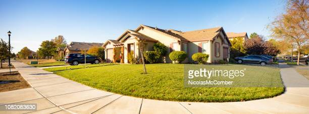 suburban california houses driveways and sidewalks on a sunny day panorama - curb stock pictures, royalty-free photos & images