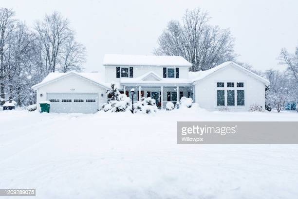 suburban colonial home during extreme blizzard snow storm - blizzard stock pictures, royalty-free photos & images