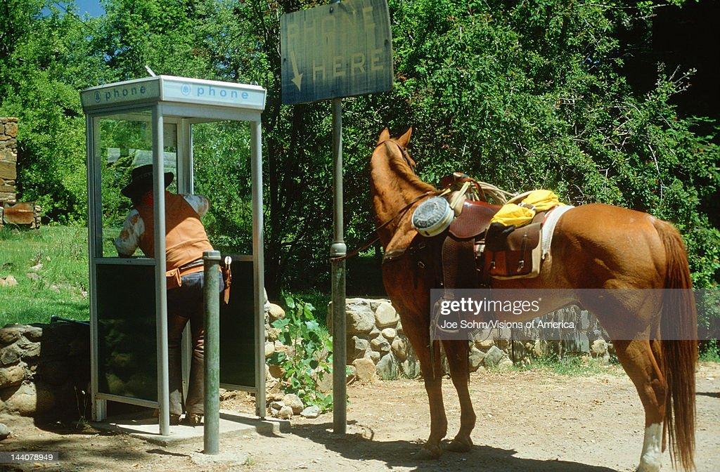 Suburban cowboy using a pay telephone, El Dorado California