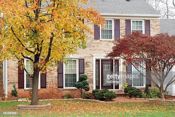 suburban house in autumn - brick house stock pictures, royalty-free photos & images