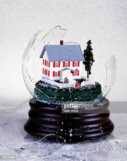 Suburban house inside broken snowglobe