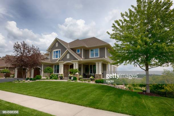 suburban house - landscaped stock pictures, royalty-free photos & images
