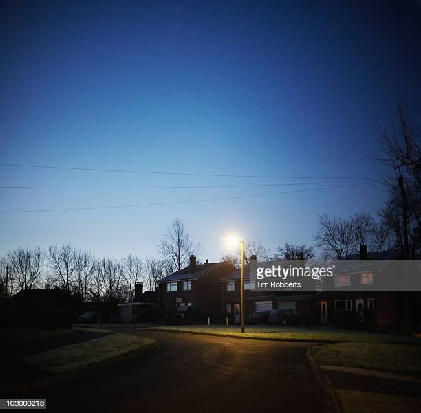 suburban houses at dawn. - street light stock pictures, royalty-free photos & images