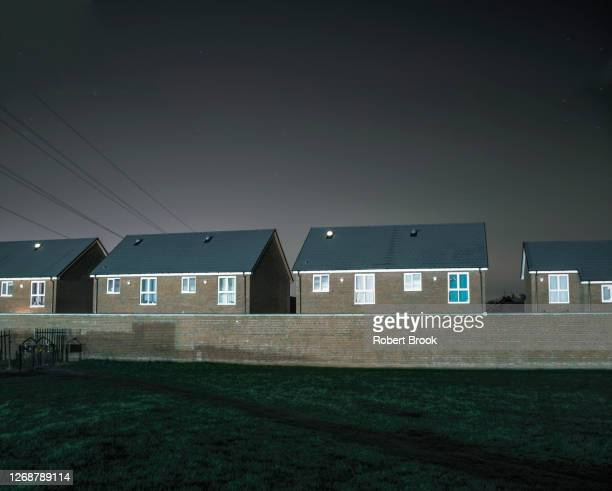 suburban houses behind wall at edge of park, west midlands. - west midlands stock pictures, royalty-free photos & images