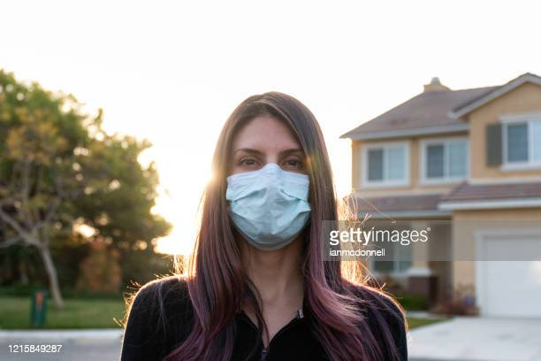 suburban pandemic - nose mask stock pictures, royalty-free photos & images