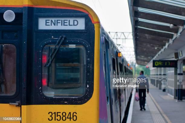 Suburban railway station and train London UK